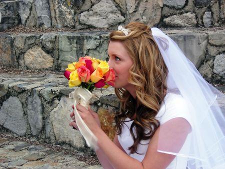 A bride smelling her bouquet
