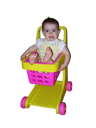 A baby girl sitting in a toy shopping cart