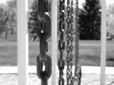 Close-up of a chain on a swing-set at a park
