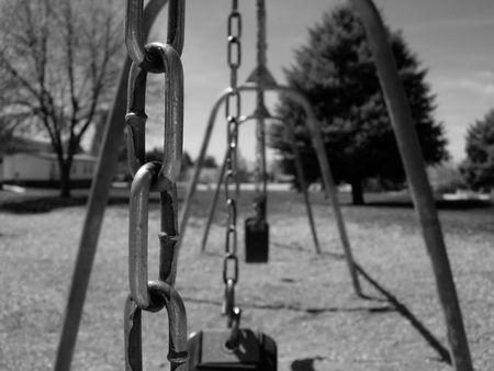 Close-up of chains on a swing-set at a park