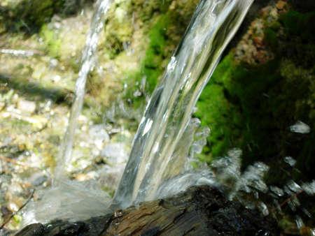 Water splashing on a piece of wood