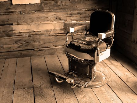 or rust: An old western barbers  dentists chair Stock Photo