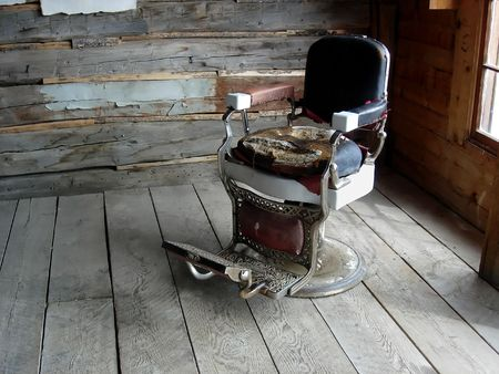 antique chair: An old western barbers  dentists chair Stock Photo