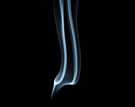 A trail of smoke on a black background