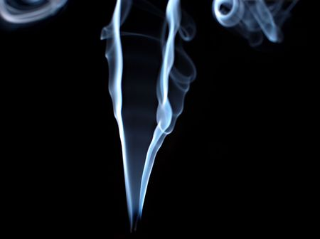 A trail of smoke on a black background photo