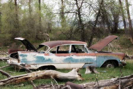 An old car left in the middle of a field Stock Photo - 5113076