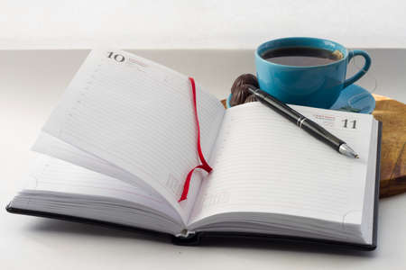 evocative: notebook with a pencil and tea