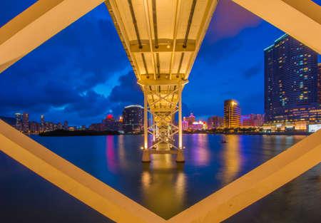 Twilight cityscape of bridge and skyscraper Macao photo