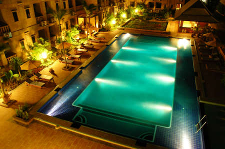Hotel swimming pool at night time
