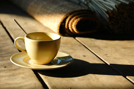 Coffee cup on rustic table photo
