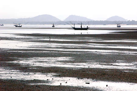 Dry beach with fisherman boat photo