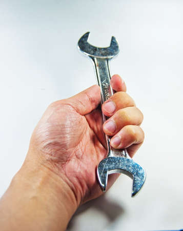 Hand with a wrench  photo