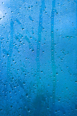 drizzle: Water drops on Blue Metallic paint  Stock Photo