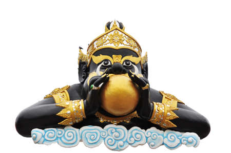 Statue of black deity called Rahu on white background  photo