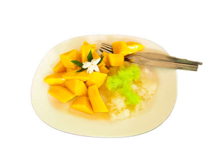 Thai style tropical dessert, glutinous rice eat with mangoes Stock Photo