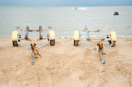boat trailer: boat Trailer on beach Stock Photo
