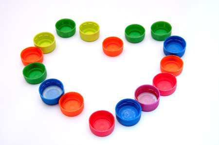 pile reuse: heart shape frome Colorful plastic bottle screw caps Stock Photo