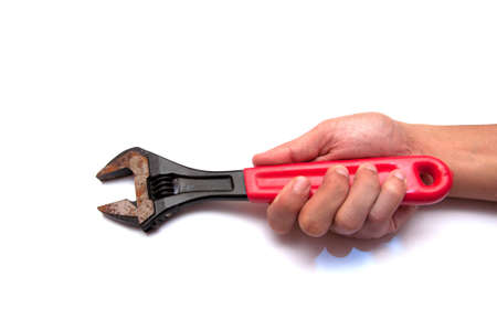hand holds a wrench  photo