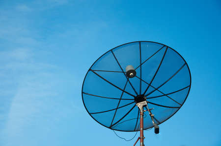 Satellite dish on blue sky  photo
