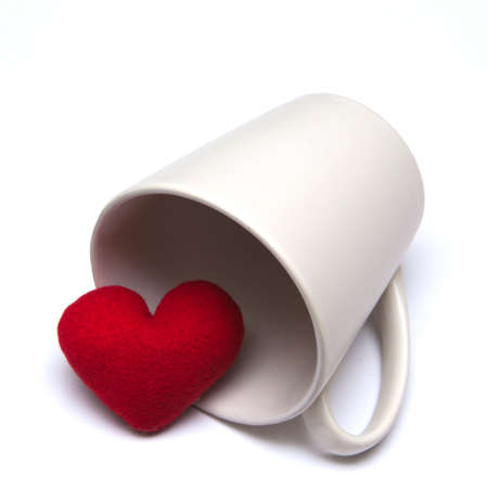 coffee cup and heart  isolated on white  background photo
