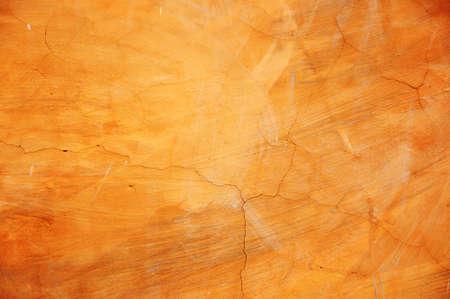 Colorful orange concrete wall
