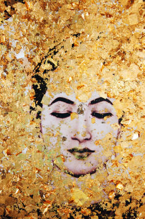 Buddha statue covered with gold stickers offered by religious thai people