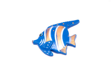 tropical fish toy isolated on white background photo