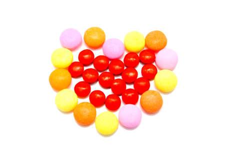 Heart shape frome orange candy photo
