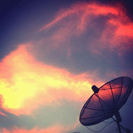 Satellite dish with sunset sky