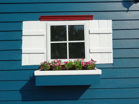 White window and blue wood wall