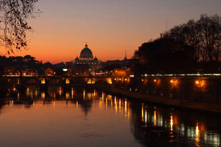 Reflection of St. Peter's Basilica in the river Tiber at sunset, near Castel Sant'Angelo