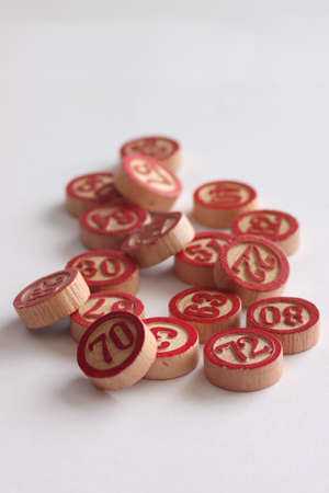 Circular wooden numbers to play bingo photo