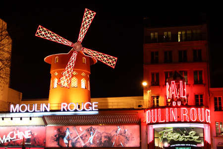 Paris, France, 13 March 2011: Night external view of the Moulin Rouge Editorial