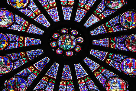 Paris, France, 9 March 2011: Stained glass window of the Cathedral of Notre Dame de Paris Stock Photo - 9232301