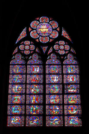 Paris, France, 9 March 2011: Stained glass window of the Cathedral of Notre Dame de Paris Stock Photo - 9232302