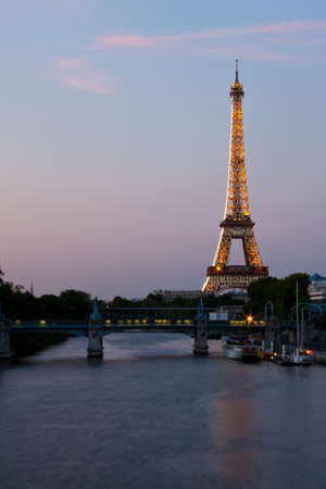 Paris, France, 02 June 2011 - Eiffel Tower illuminated at sunset