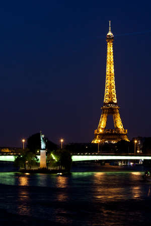 Paris, France, 02 June 2011 - The Eiffel Tower and the Statue of Liberty in the night Stock Photo - 10666677