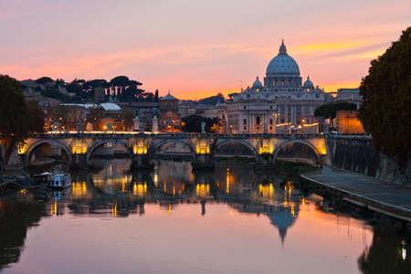 tevere: Saint Peter Basilica at sunset.