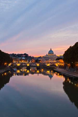 Rome at dusk: Saint Peter Basilica after sunset. photo