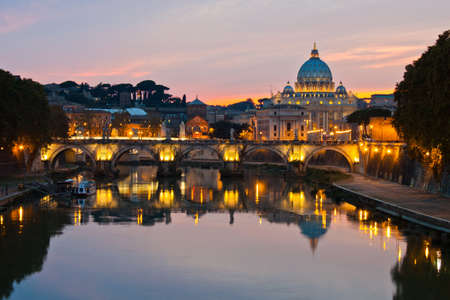 peter: Rome at dusk: Saint Peter Basilica after sunset. Stock Photo