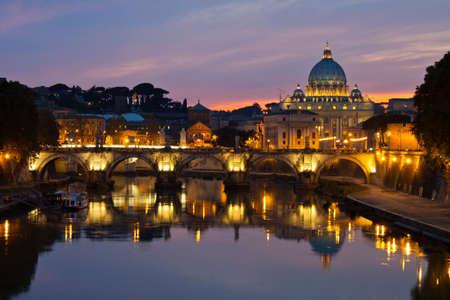 vatican city: Rome at dusk: Saint Peter Basilica after sunset. Stock Photo