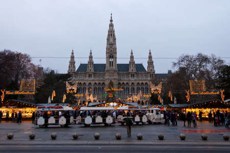 Vienna, Austria, 21 December 2011 - The Vienna City Hall (Rathaus) with Christmas Market. In the square in front of the building there is one of the most famous Christmas Market in the world.