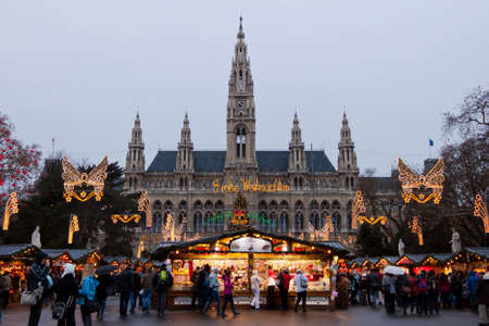 christkindlmarkt: Vienna, Austria, 21 December 2011 - The Vienna City Hall (Rathaus) with Christmas Market. In the square in front of the building there is one of the most famous Christmas Market in the world. Editorial