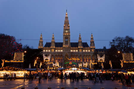 Vienna, Austria, 21 December 2011 - The Vienna City Hall (Rathaus) with Christmas Market. In the square in front of the building there is one of the most famous Christmas Market in the world. Editorial