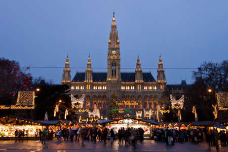 neogothic: Vienna, Austria, 21 December 2011 - The Vienna City Hall (Rathaus) with Christmas Market. In the square in front of the building there is one of the most famous Christmas Market in the world. Editorial