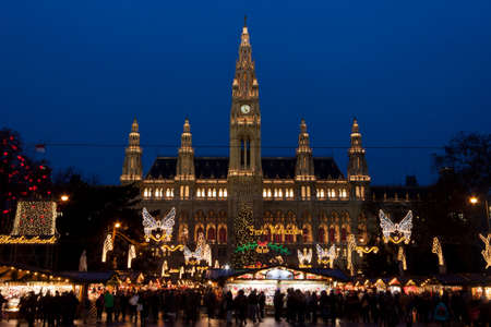 christma: Vienna, Austria, 21 December 2011 - The Vienna City Hall (Rathaus) with Christmas Market. In the square in front of the building there is one of the most famous Christmas Market in the world. Editorial