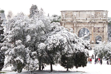 Rome, Italy, 4 February 2012 - Amazing view of the Arch of Constantine with snow. Snowfalls in Rome are very rare, the last similar snowfall was in 1985. Stock Photo - 12160289
