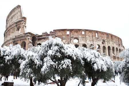 Rome, Italy, 4 February 2012 - Amazing view of the Coliseum with snow. Snowfalls in Rome are very rare, the last similar snowfall was in 1985.