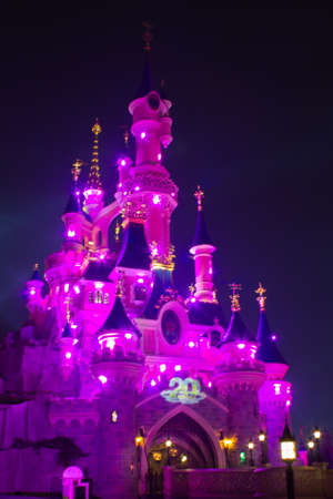Paris, France, 18 February 2012 - Disneyland Paris Castle illuminated at night during the 20th anniversary. Disneyland Paris is a holiday and recreation resort in Paris. It is the most visited themed attraction of Europe. Stock Photo - 12573043