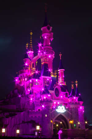 Paris, France, 18 February 2012 - Disneyland Paris Castle illuminated at night during the 20th anniversary. Disneyland Paris is a holiday and recreation resort in Paris. It is the most visited themed attraction of Europe.